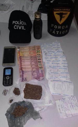 Objetos e dinheiro apreendido pela PM em Pedro Afonso_300.jpg