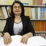 Maria Dinalva Tavares é a professora de Braille
