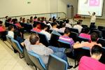 No auditório da ATS, servidores assistem à palestra do médico Roberto de Muzio