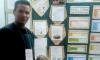 Acadêmico Hugo Araújo Salis, no estande de exposição do seu trabalho sobre babaçu, selecionado para mostra internacional