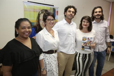 A secretária e os membros da equipe da ONG Repórter Brasil