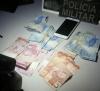 Celular e dinheiro recuperados pela PM.png