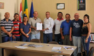 Protocolo que instruí o processo de regularização fundiária do loteamento Flamboyant I entregue aos representantes legais do município de Miracema do Tocantins