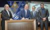 Assinatura teve como testemunha o desembargador Marco Villas Boas e o secretário da Casa Civil, Rolf Vidal